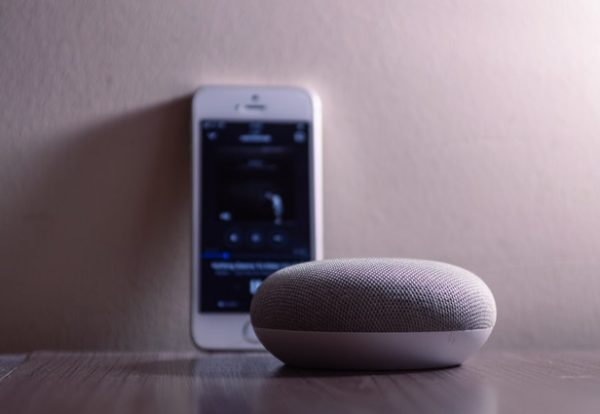 gray-google-home-mini-beside-silver-iphone-5s-1279365