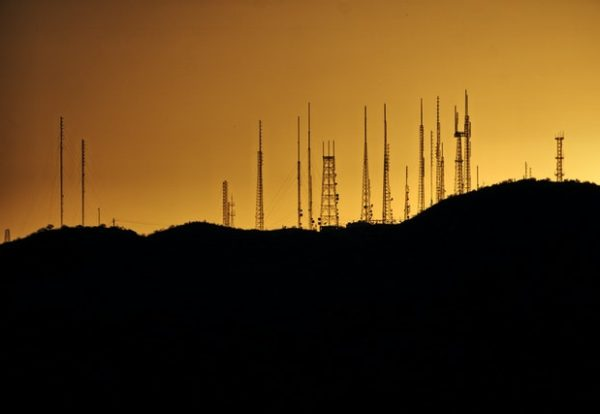 silhouette-photo-of-transmission-tower-on-hill-2525871